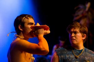 Ben Ellerbrock (right) encourages Jonah Gercke to assert his leadership by blowing the conch