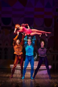 Megan Sikora is lifter by , left to right, Barrett Martin, Giovanni Bonaventura and Tyler Hanes in the Old Globe's Kiss Me, Kate. T Charles Erickson Photo.