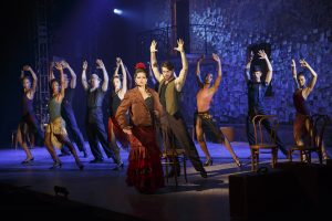 "Glenda Sol Koeraus and Henry Byalikov (foreground) with the cast in Nilo Cruz's vignette ""The Lover's Jacket,"" part of the world premiere musical In Your Arms. In Your Arms, with music by Stephen Flaherty and direction and choreography by Christopher Gattelli, runs Sept. 16 - Oct. 25, 2015 at The Old Globe. Photo by Carol Rosegg."